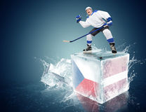 Czech republic - Latvia game. Spunky hockey player on ice cube Stock Photo