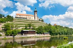 Renaissance Chateau and Church of Sts. Peter and Paul, Labe river, Melnik, Czech Republic. CZECH REPUBLIC, MELNIK - APR 27, 2016: Renaissance Chateau and Church Royalty Free Stock Images