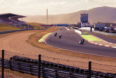CZECH REPUBLIC, MOST, 25 JULY,  2015:Trainings of motorbikes on the race track.Sunset sky. Royalty Free Stock Photo