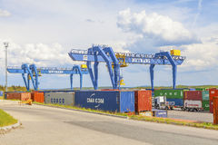 CZECH REPUBLIC, NYRANY, 27 APRIL, 2015: Nyrany container terminal. Industrial crane loading containers. Royalty Free Stock Photo