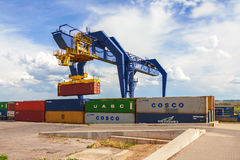 CZECH REPUBLIC, NYRANY,  27 APRIL,  2015: Nyrany container terminal. Industrial crane loading containers. Stock Photo