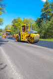 CZECH REPUBLIC, PLZEN,7 MAY, 2016:Asphalt spreading machine and vibration roller  at pavement road works. Stock Photo