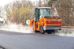 CZECH REPUBLIC, PLZEN, 7 MAY, 2016:Asphalt spreading machine and vibration roller  at pavement road works. Royalty Free Stock Image