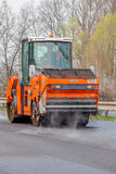 CZECH REPUBLIC, PLZEN, 7 MAY, 2016:Asphalt spreading machine and vibration roller  at pavement road works. Royalty Free Stock Photos