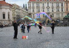 Czech Republic. Prague - April 10, 2013: Unidentified young woman makes soap bubbles in Old Town Square Staromestske namesti royalty free stock image