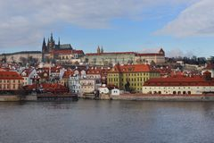 Czech Republic Prague, a beautiful view of the roofs of houses and Prague Castle. Over the river of Vltava from the Charles Bridge Stock Image