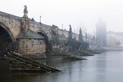 Czech Republic, Prague, Charles Bridge during typical fog autmn atmosphere Stock Photography