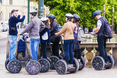 CZECH REPUBLIC, PRAGUE - MAY 21, 2016:a tour guide leads a grou. P of tourists traveling on the Segway through the streets of Prague royalty free stock images