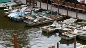 Czech Republic, Prague. Old Small Boats Parked in the Dock. Boats parked in harbor stock footage