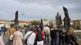 Crowd of people walking along the Charles Bridge, Prague, Czech Republic. Slow Motion stock footage