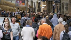 Crowd of People walking along the urban street of the old city in Prague, Czech Republic. Slow Motion stock footage