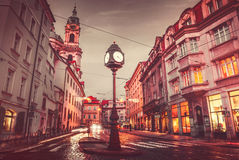 Czech Republic Prague square with old street lamp clock. Dark evening sky retro vintage roofs Stock Image