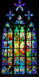 Czech Republic, Prague: stained glass of St Vitus. Czech Republic, Prague: colorful stained glass of St Vitus cathedral; blue with red and green holy stock image