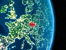 Czech republic in red at night. Czech republic from orbit of planet Earth at night with visible borderlines and city lights. 3D illustration. Elements of this Stock Photos