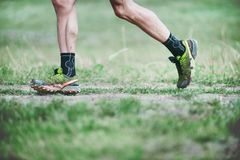 Free CZECH REPUBLIC, SLAPY, October 2018: Trail Maniacs Run Competition. Legs Of The Runner In Green Salomon Running Shoes. Royalty Free Stock Images - 129944789