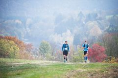 Free CZECH REPUBLIC, SLAPY, October 2018: Trail Maniacs Run Competition. Runners On The Meadow With Autumnal Background.. Stock Photography - 129918492