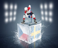 Czech Republic - Sweden game. Face-off player on the ice cube. Stock Image
