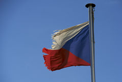 Czech Republic torn old flag against blue sky. Flying in wind Royalty Free Stock Photos