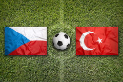 Czech Republic vs. Turkey flags on soccer field Stock Photos