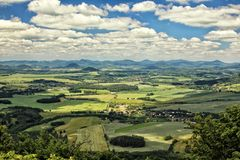 Czech rural landscape with green fields and villages Stock Photo