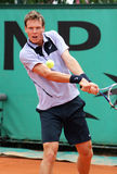 Czech's Tomas Berdych at French Open. Czech's top tennis player Tomas Berdych hits double backhand during his match at Roland Garros, French Open, Paris, France Royalty Free Stock Photography