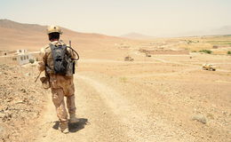 Czech Soldier in Logar Province, Afghanistan. Military member of Czech Provincial Reconstruction Team walking down from a hill in Muhammad Agha District, Logar Royalty Free Stock Photo
