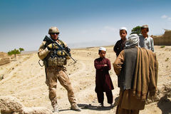 Czech soldier speaking to afghan villagers Stock Photos