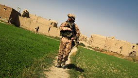 Czech soldier walking in Afghanistan Stock Images