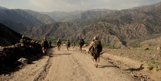 Czech Soldiers in Logar Province, Afghanistan. Czech soldiers from Provincial Reconstruction Team walking in mountains in Azra district, Logar Province Royalty Free Stock Photo