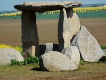 Czech `Stonehenge`. Is located in West Bohemia, Czech Republic. There are villages and fields in the background. The photo was taken on: May 16, 2017 stock photography