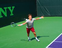 Czech Tennis Player Tomas Berdych at Sony Open. Czech tennis player Tomas Berdych stetches to hit a wide forehand at the 2014 Sony Open in Key Biscayne, Florida Stock Image