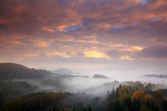 Czech typical autumn landscape. Hills and forest with foggy morning. Morning fall valley of Bohemian Switzerland park. Hills with. Pink clouds stock photos