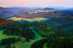 Czech typical autumn landscape. Hills and villages with foggy morning. Morning fall valley of Bohemian Switzerland park. Hills wit royalty free stock photo