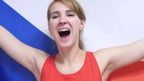 Czech Young Woman celebrating while holding the flag of Czech Republic in Slow Motion. High quality royalty free stock images