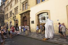 Czechia actor people acting Magic show on street for show near Charles Bridge. Czechia actor people acting Magic show on street for show Czechia people and Royalty Free Stock Photo