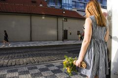 Czechia girl holding yellow flower bouquet and waiting at tramway station near PALLADIUM Shopping Center Stock Photos
