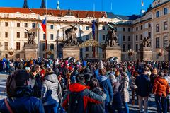 Czechia people and foreigner travelers waiting for the Changing The Guard at gate front of Prague castle in Prague, Czech Republic Stock Image