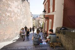 Czechia two women sit and drawing watercolor painting Prague city. With dog sleep on pathway of Prague castle on August 31, 2017 in Prague, Czech Republic royalty free stock photo