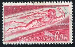 Man Flying into Space. CZECHOSLOVAKIA - CIRCA 1961: stamp printed by Czechoslovakia, shows Man Flying into Space, circa 1961 stock photos