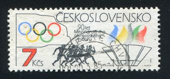 Runners. CZECHOSLOVAKIA - CIRCA 1984: stamp printed by Czechoslovakia, shows Rings, runners, torch, circa 1984 stock photos