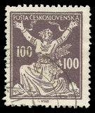Breaking Chains to Freedom. Czechoslovakia - stamp printed 1920, Standard printing in brown color, Series Allegory of Republic, Breaking Chains to Freedom Stock Photos