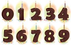 Czekoladowe liczb świeczki dla wakacje torta Zdjęcie Royalty Free