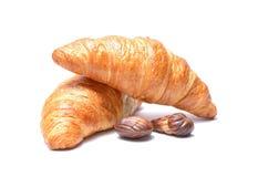 Czekoladowy croissant i cukierki odizolowywający na bielu Zdjęcia Stock
