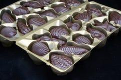 Czekoladowy cukierek na czarnym aksamitnym tle Fotografia Stock