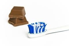 czekoladowy cukierki wpólnie toothbrush Fotografia Stock