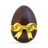 Czekoladowy Easter jajko z żółtym faborkiem na bielu Obrazy Royalty Free