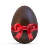 Czekoladowy Easter jajko z czerwonym faborkiem na bielu Obrazy Royalty Free