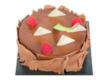 Czekoladowy tort z jagodami odizolowywać fotografia royalty free