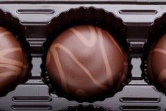 Czekoladowych cukierków zakończenie obraz stock
