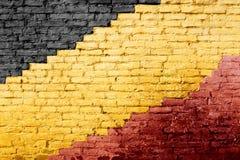Czerń, kolor żółty i czerwień malujący ściana z cegieł, Fotografia Stock